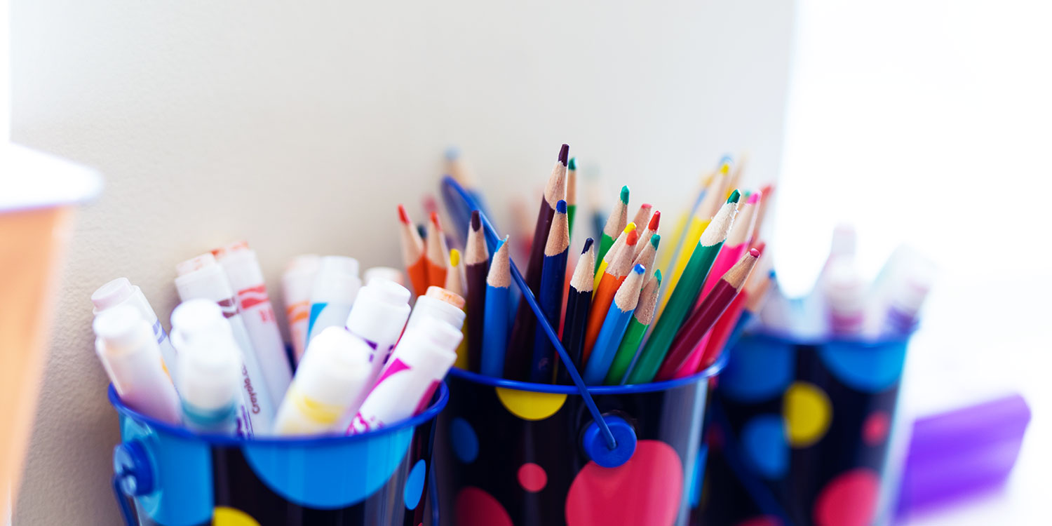 Art supplies in bright containers.