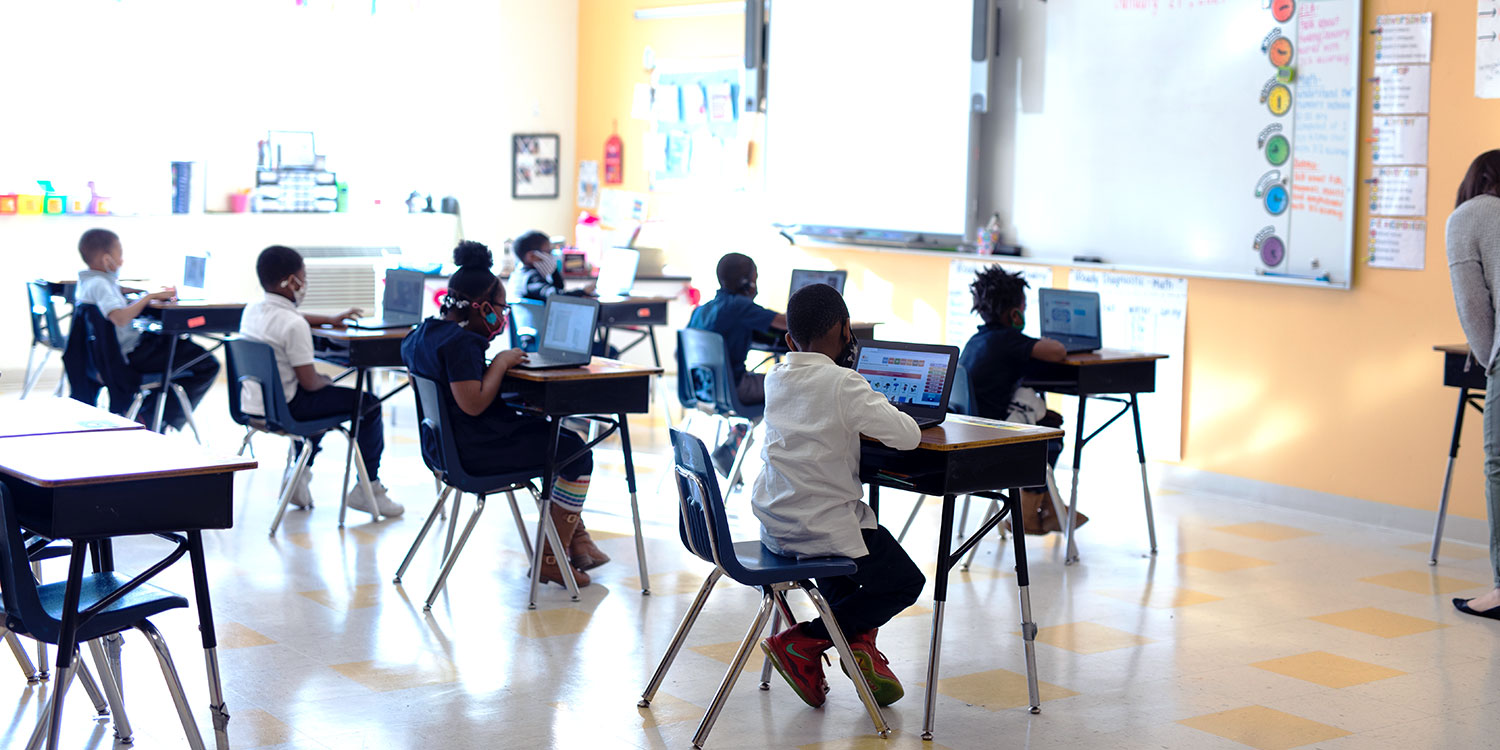 Students in classroom sitting at desks.
